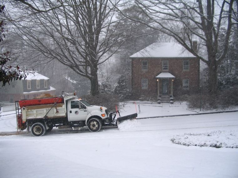 Snow Plow Clearing Street